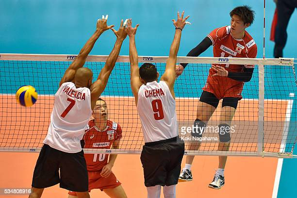 Yuki Ishikawa of Japan spikes the ball during the Men's World Olympic Qualification game between Japan and Venezuela at Tokyo Metropolitan Gymnasium...