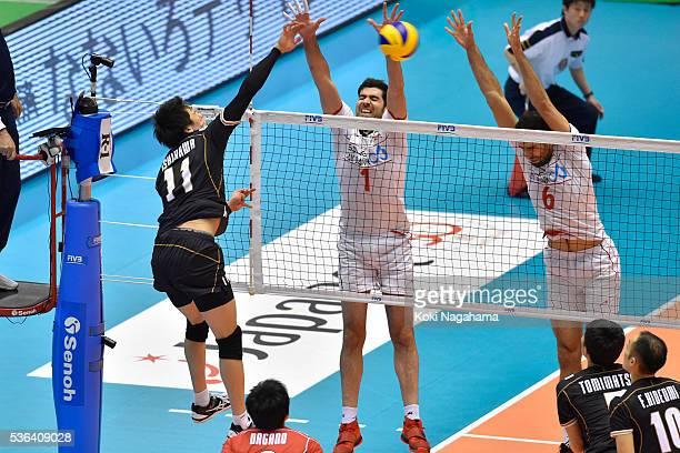 Yuki Ishikawa of Japan spikes the ball during the Men's World Olympic Qualification game between Japan and Iran at Tokyo Metropolitan Gymnasium on...