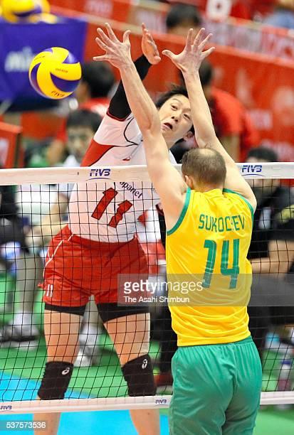 Yuki Ishikawa of Japan spikes the ball during the Men's World Olympic Qualification game between Australia and Japan at Tokyo Metropolitan Gymnasium...