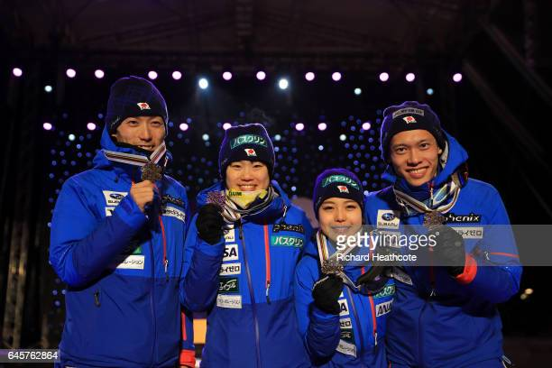 Yuki Ito Daiki ItoTaku Takeuchi and Sara Takanashi of Japan celebrate their bronze medal in the Mixed Team HS100 Normal Hill Ski Jumping during the...