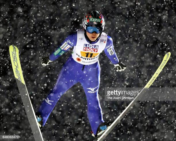 Yuki Ito of Japan competes in the first jump of the Mixed Team HS100 Normal Hill Ski Jumping during the FIS Nordic World Ski Championships on...