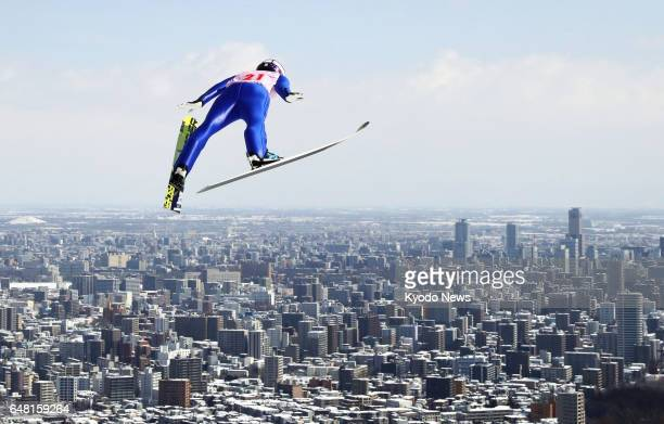 Yuki Ito of Japan flies in the northern Japan city of Sapporo on March 5 during the women's large hill competition at the International Miyasama Ski...