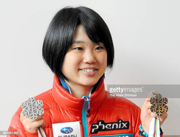 Yuki Ito of Japan shows her medals upon arrival at Tokyo International Airport on February 24 2015 in Tokyo Japan