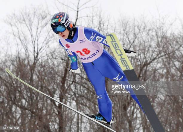Yuki Ito of Japan soars through the air en route to winning the women's normal hill event at the International Miyasama Ski Games in Sapporo on March...