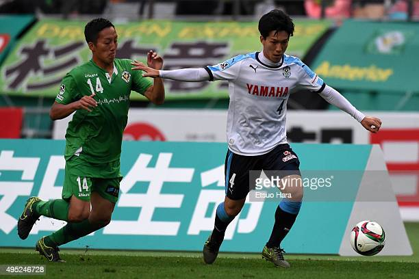 Yuki Kabayashi of Jubilo Iwata and Naoto Sawai of Tokyo Verdy compete for the ball during the JLeague second division match between Tokyo Verdy and...
