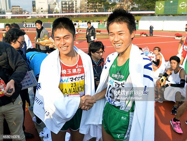 Yuki Kawauchi and his younger brother Koki shake hands after the 67th Fukuoka International Open Marathon on December 1 2013 in Fukuoka Japan