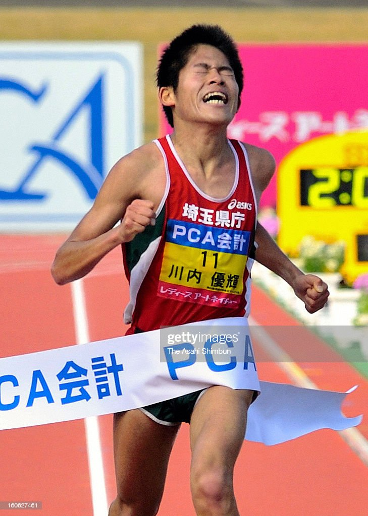 Yuki Kawauchi crosses the finishing tape to win in the 62nd Beppu-Oita Mainichi Marathon at Oita City Stadium on February 3, 2013 in Oita, Japan.