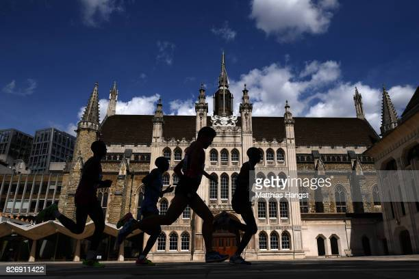 Yuki Kawauchi of Japan and other athletes pass the Guildhall for the second time in the Men's Marathon during day three of the 16th IAAF World...