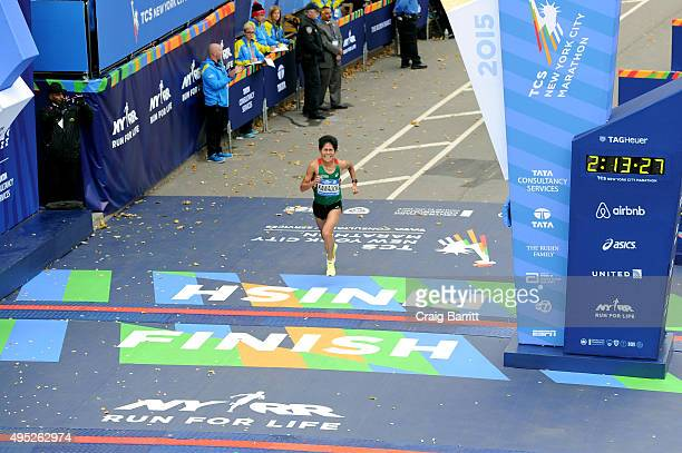 Yuki Kawauchi of Japan crosses the finish line at TAG Heuer Official Timekeeper and Timepiece of 2015 TCS New York City Marathon on November 1 2015...