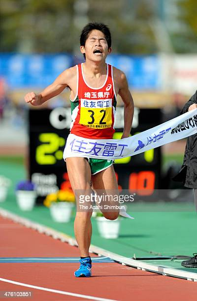 Yuki Kawauchi of Japan crosses the finishing tape as fourth during the 69th Lake Biwa Mainichi Maration at Ojiyama Stadium on March 2 2014 in Otsu...