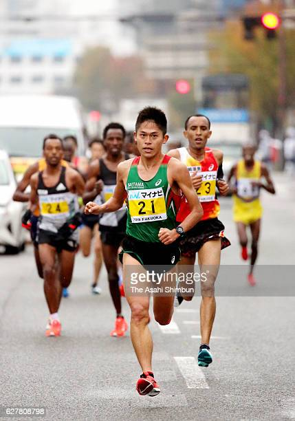 Yuki Kawauchi of Japan leads the pack during the Fukuoka International Marathon on December 4 2016 in Fukuoka Japan