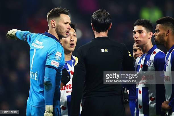 Yuki Kobayashi and Goalkeeper Erwin Mulder of sc Heerenveen speak to referee Bas Hijhuis during the Dutch Eredivisie match between PSV Eindhoven and...