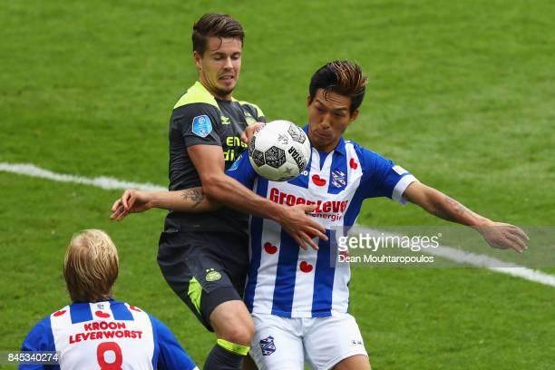 Yuki Kobayashi of Heerenveen battles for the ball with Marco van Ginkel of PSV during the Dutch Eredivisie match between SC Heerenveen and PSV...