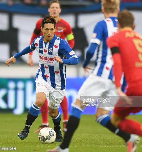 Yuki Kobayashi of Heerenveen dribbles the ball during the first half of a Dutch Eredivisie soccer match against AZ Alkmaar at Abe Lenstra Stadion in...