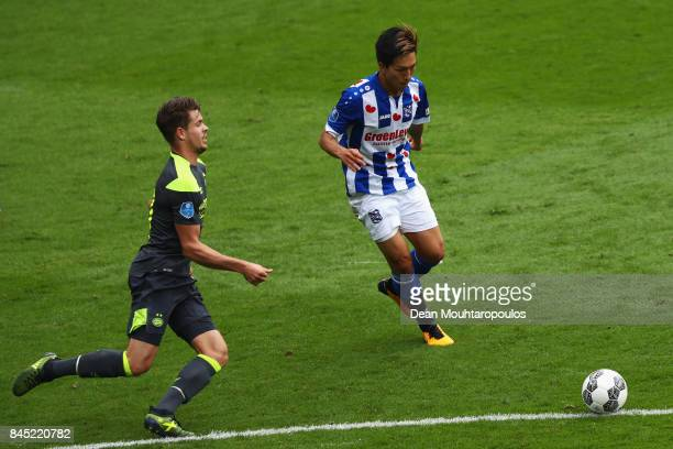 Yuki Kobayashi of Heerenveen gets past the tackle from Marco van Ginkel of PSV during the Dutch Eredivisie match between SC Heerenveen and PSV...