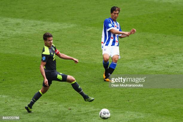 Yuki Kobayashi of Heerenveen gets past the tackle from Marco van Ginkel of PSV during the Dutch Eredivisie match between SC Heerenveen and PSV...