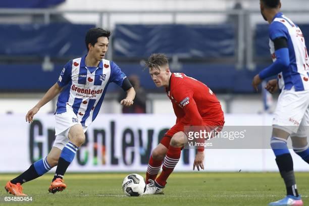 Yuki Kobayashi of Heerenveen Wout Weghorst of AZ Alkmaarduring the Dutch Eredivisie match between sc Heerenveen and AZ Alkmaar at Abe Lenstra Stadium...