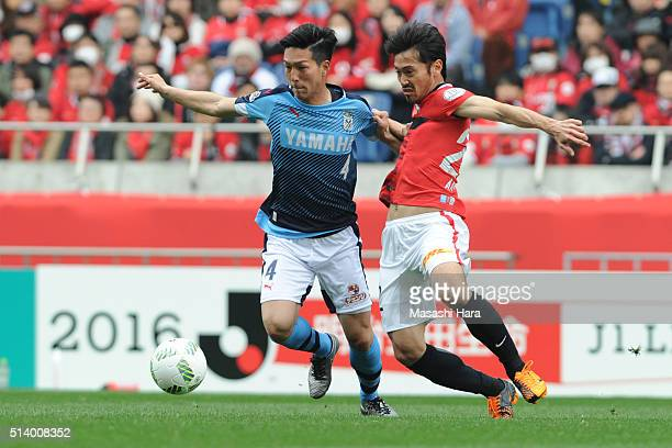 Yuki Kobayashi of Jubilo Iwata and Yuki Abe of Urawa Red Diamonds compete for the ball during the JLeague match between Urawa Red Diamonds and Jubilo...