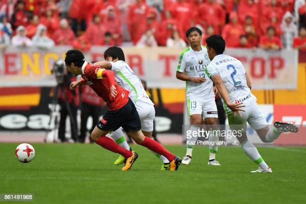 Yuki Kobayashi of Nagoya Grampus and Temma Matsuda of Shonan Bellmare compete for the ball during the JLeague J2 match between Nagoya Grampus and...