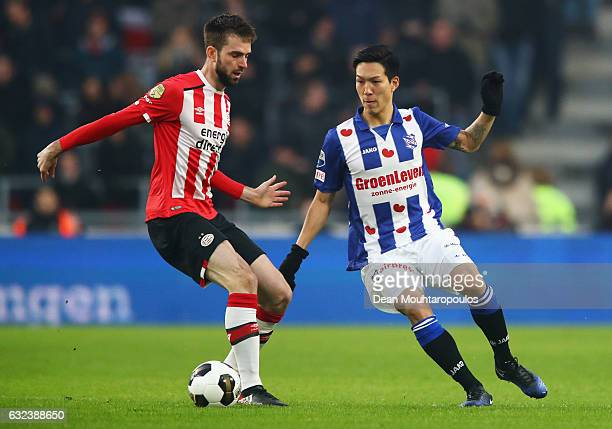 Yuki Kobayashi of sc Heerenveen battles for the ball with Davy Propper of PSV during the Dutch Eredivisie match between PSV Eindhoven and SC...