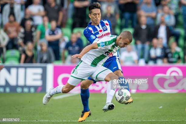 Yuki Kobayashi of sc Heerenveen Jesper Drost of FC Groningen during the Dutch Eredivisie match between FC Groningen and sc Heerenveen at Noordlease...