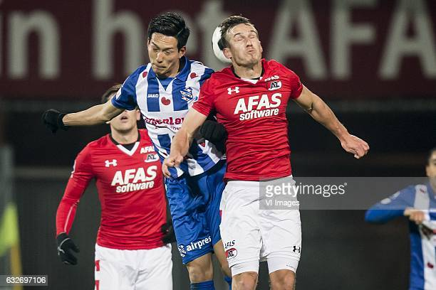 Yuki Kobayashi of SC Heerenveen Mats Seuntjens of AZ Alkmaarduring the Dutch Cup quarter final match between AZ Alkmaar and sc Heerenveen at AFAS...