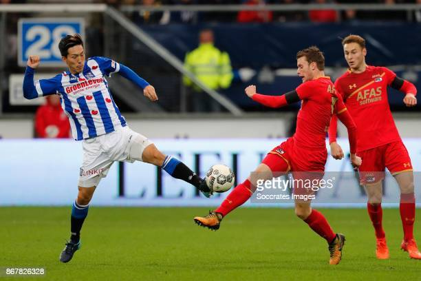 *Yuki Kobayashi* of SC Heerenveen *Thomas Ouwejan* of AZ Alkmaar during the Dutch Eredivisie match between SC Heerenveen v AZ Alkmaar at the Abe...