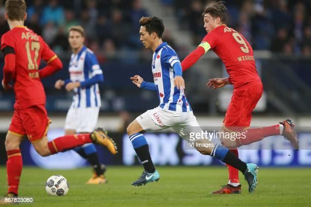 Yuki Kobayashi of sc Heerenveen Wout Weghorst of AZ during the Dutch Eredivisie match between sc Heerenveen and AZ Alkmaar at Abe Lenstra Stadium on...