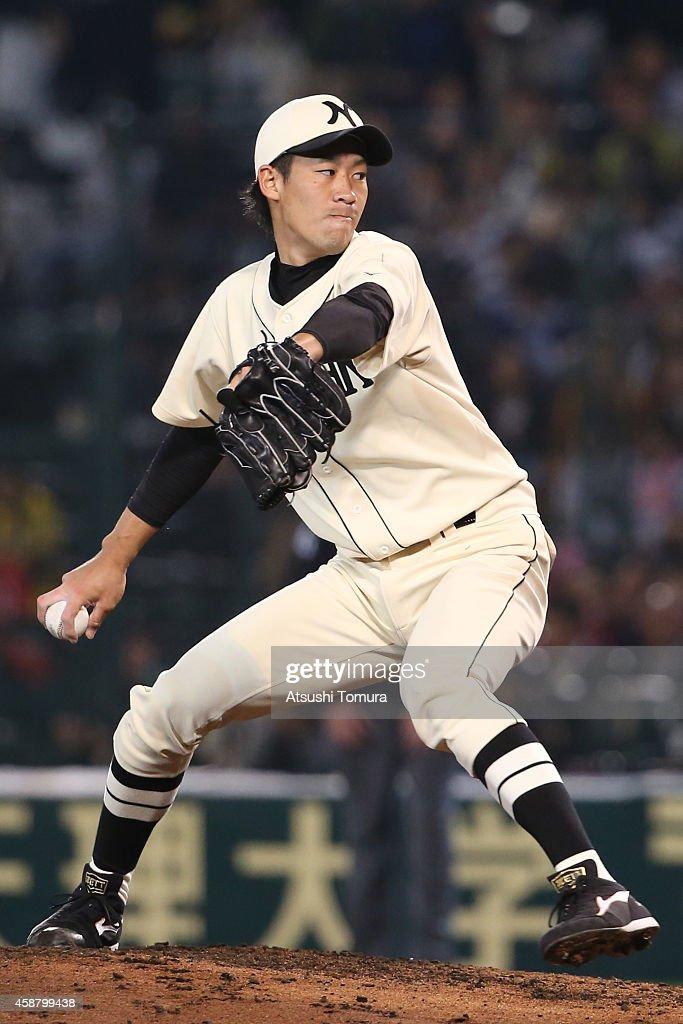Yuki Koyama of Hanshin Tigers and Yomiuri Giants pitches during the friendly match between Hanshin Tigers and Yomiuri Giants at the Hanshin Koshien...
