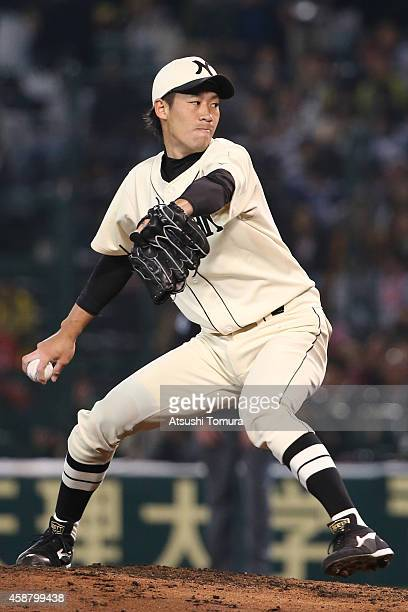 Yuki Koyama of Hanshin Tigers and Yomiuri Giants pitches during the friendly match between Hanshin Tigers and Yomiuri Giants at the Hanshin Koshien...