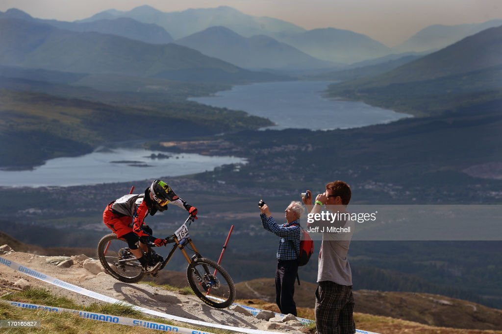 Yuki Kushima of Japan competes in the men's downhill qualifying round at the UCI Mountain Bike World Cup on June 8, 2013 in Fort William, Scotland.