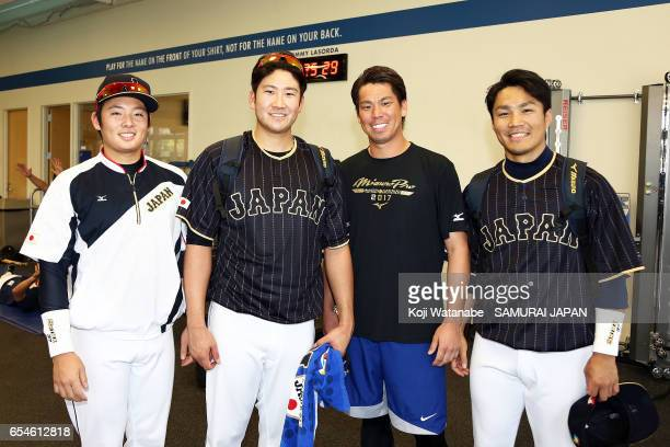 Yuki Matsui and Kenta Maeda of the Los Angeles Dodgers and Tomoyuki Sugano and Takahiro Norimoto of Japan pose for photographs during a workout ahead...