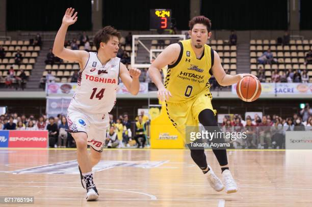 Yuki Mitsuhara of the SunRockers handles the ball under pressure from Naoto Tsuji of the Kawasaki Brave Thunders during the B League match between...