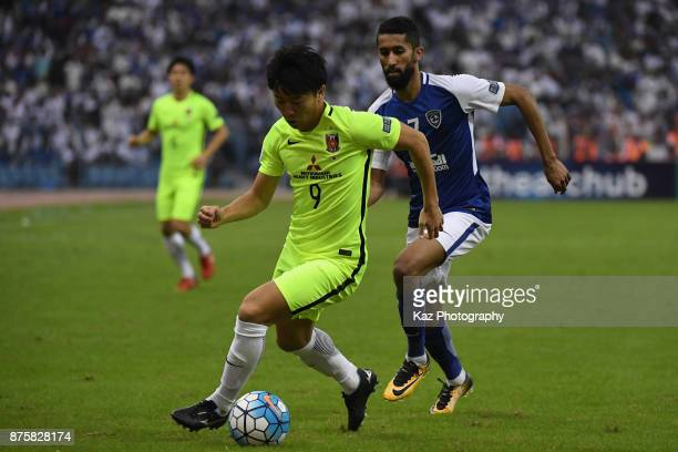 Yuki Muto of Urawa Red Diamonds and Salman Al Faraj of AlHilal compete for the ball during the AFC Champions League Final 2017 first leg between...