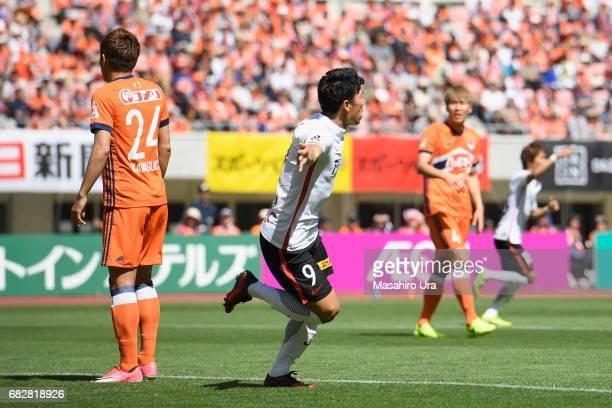 Yuki Muto of Urawa Red Diamonds celebrates scoring his side's first goal during the JLeague J1 match between Albirex Niigata and Urawa Red Diamonds...