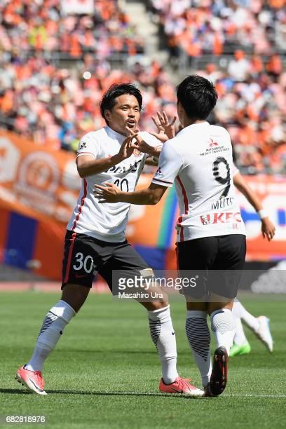 Yuki Muto of Urawa Red Diamonds celebrates scoring his side's first goal with his team mate Shinzo Koroki during the JLeague J1 match between Albirex...