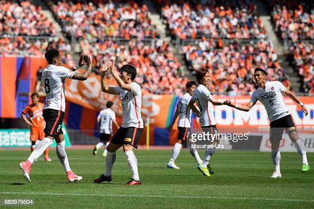 Yuki Muto of Urawa Red Diamonds celebrates scoring the opening goal with his team mate Rafael Silva during the JLeague J1 match between Albirex...