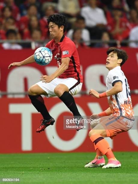 Yuki Muto of Urawa Red Diamonds in action during the AFC Champions League Round of 16 match between Urawa Red Diamonds and Jeju United FC at Saitama...