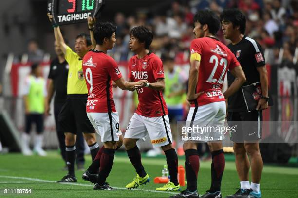 Yuki Muto of Urawa Red Diamonds is replaced by Yoshiaki Komai during the JLeague J1 match between Urawa Red Diamonds and Albirex Niigata at Saitama...