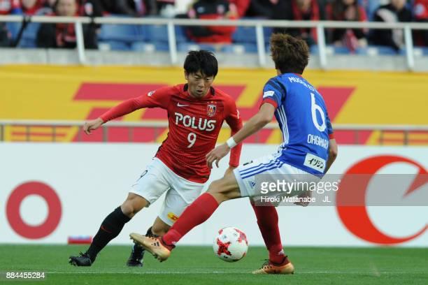 Yuki Muto of Urawa Red Diamonds takes on Takahiro Ogihara of Yokohama FMarinos during the JLeague J1 match between Urawa Red Diamonds and Yokohama...