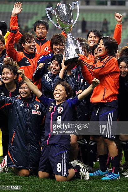 Yuki Nagasato and Aya Miyama of Japan celebrates after winning with team mate during the international friendly match between Japan and Brazil at...