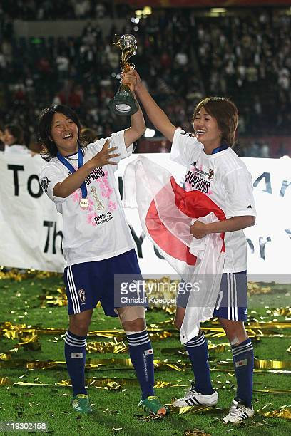 Yuki Nagasato of Japan and Kozue Ando of Japan celebrate with the winning trophy after winning 53 after penalty shootout the FIFA Women's World Cup...