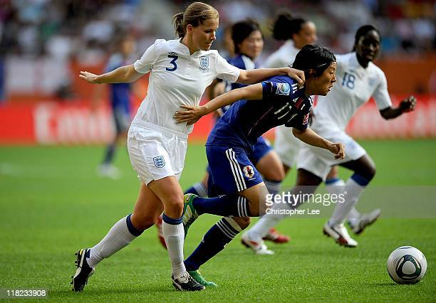 Yuki Nagasato of Japan forces her way past Rachel Unitt of England during the FIFA Womens World Cup Group B match between England and Japan in...