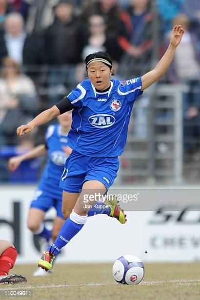 Yuki Nagasato of Potsdam runs with the ball during the Women Bundesliga match between Turbine Potsdam and EssenSchoenebeck at the KarlLiebknecht...