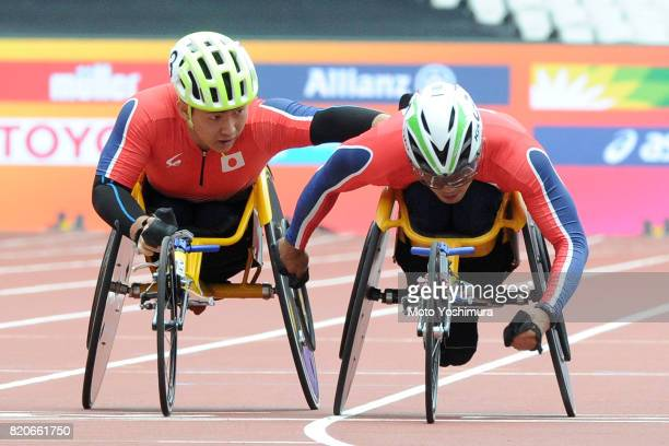 Yuki Nishi and Hitoshi Matsunaga of Japan compete in the Men's 4×400m Relay T53/54 exhibition race during day six of the IPC World ParaAthletics...