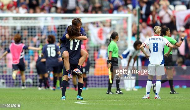 Yuki Ogimi and Shinobu Ohno of Japan celebrate after the Women's Football Semi Final match between France and Japan on Day 10 of the London 2012...