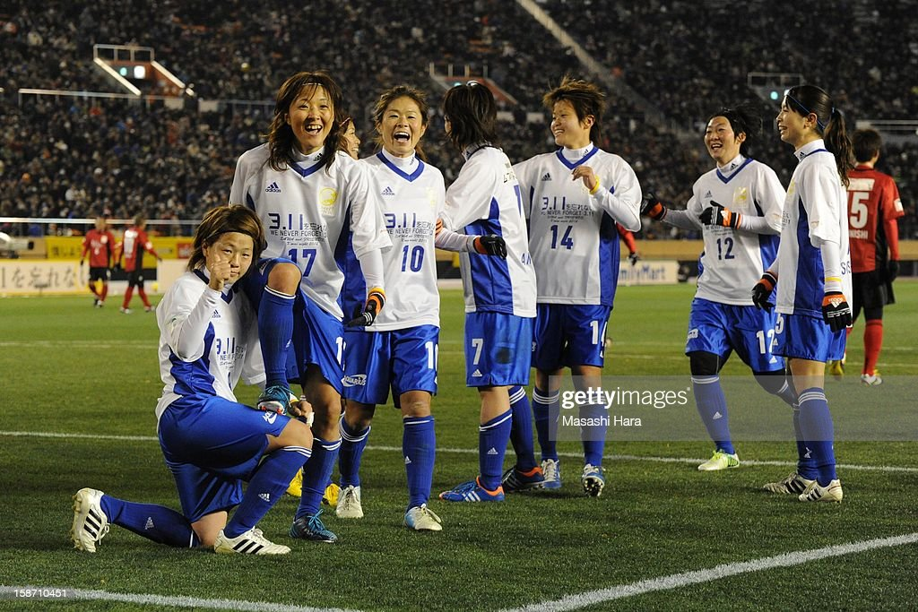 Yuki Ogimi (2nd L) celebrates with team-mates after scoring a goal during the Great East Japan Earthquake charity match 'SAWA and Friends, X'mas Night 2012' at the National Stadium on December 25, 2012 in Tokyo, Japan.
