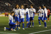 Yuki Ogimi celebrates with teammates after scoring a goal during the Great East Japan Earthquake charity match 'SAWA and Friends X'mas Night 2012' at...