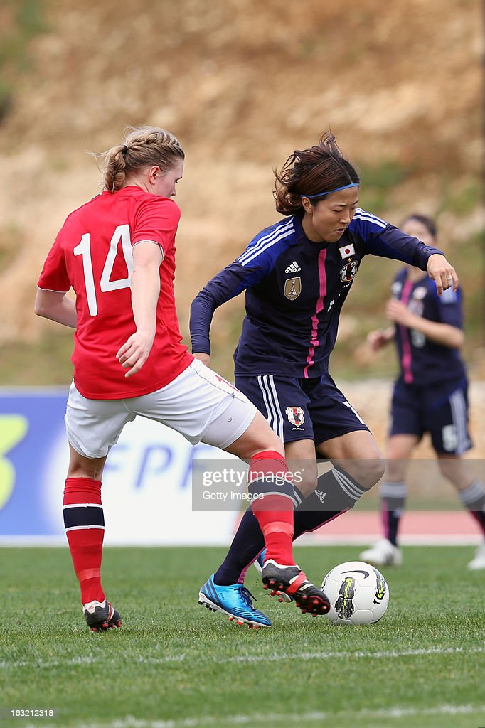 Yuki Ogimi FW of Japan challenges Ingvild Isaksen FW of Norway during the Algarve Cup match between Japan and Norway at the Complexo Desportivo Belavista on March 6, 2013 in Parchal, Portugal.