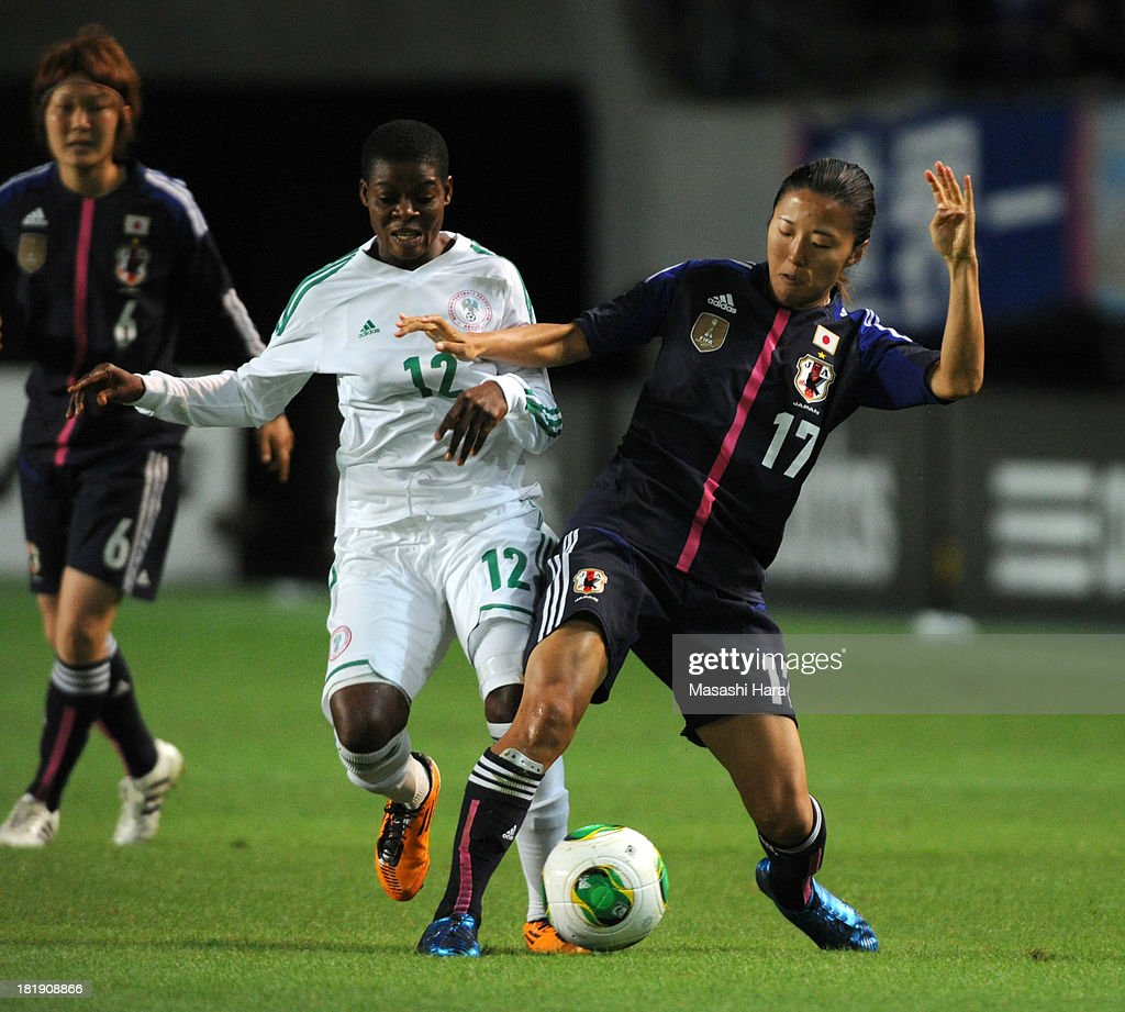 Yuki Ogimi #17 of Japan (R) and Blessing Edoho #12 of Nigeria compete for the ball during the Women's international friendly match between Japan and Nigeria at Fukuda Denshi Arena on September 26, 2013 in Chiba, Japan.